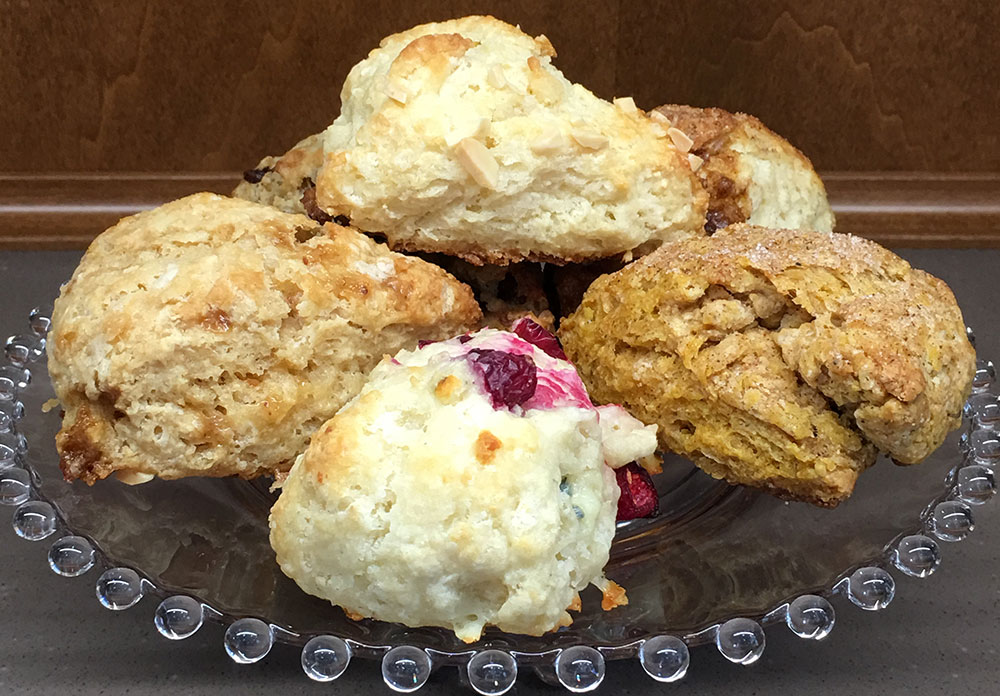 Variety of scones on glass plate