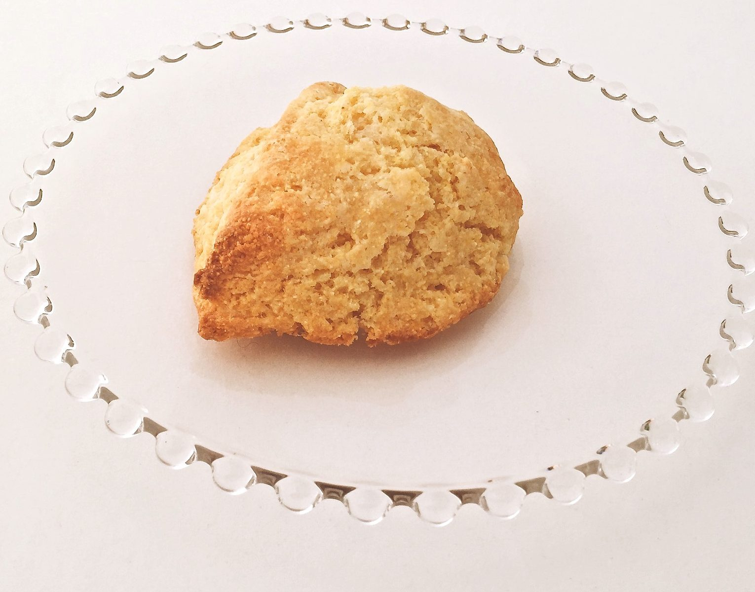 Cornmeal Scone made from Cornmeal Scone Mix sitting on glass plate