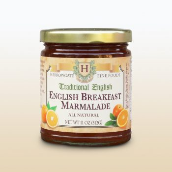 Jar of English Breakfast Orange marmalade. Jar is full of jam, with gold lid, and label which covers the front of the jar.