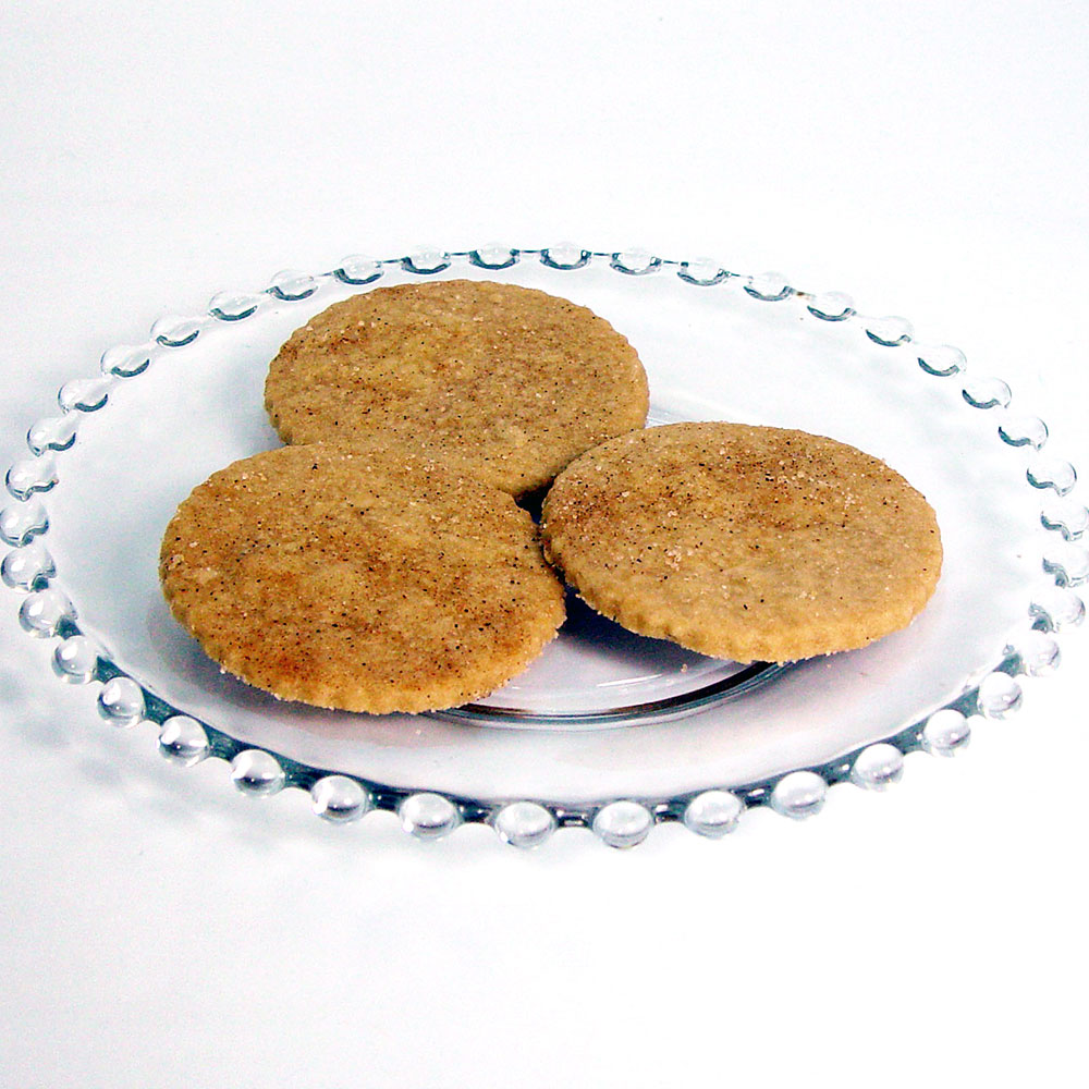 Three Lemon Ginger Shortbread Cookies made with Lemon Ginger Shortbread Cookie Mix. The cookies were baked as round wafers, and sprinkled with cinnamon sugar prior to baking.
