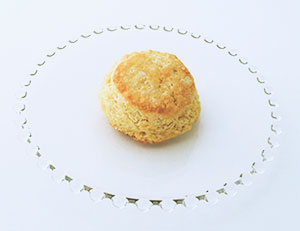 Cornmeal biscuit isolated on glass plate.