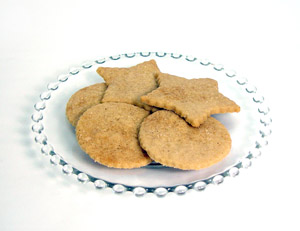 Wafer thin shortbread cookies made from brown sugar shortbread cookie mix. Two stars, 3 rounds sitting on clear glass plate.